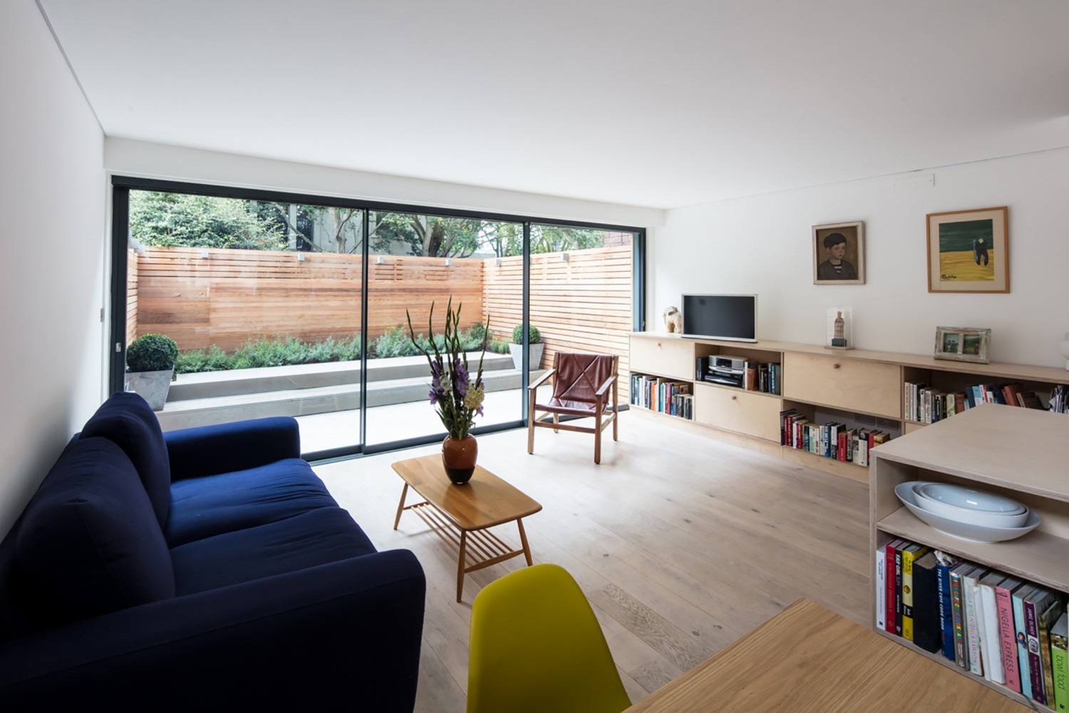 St Lukes House - Peter Morris Architects - sliding glass doors garden dog plywood