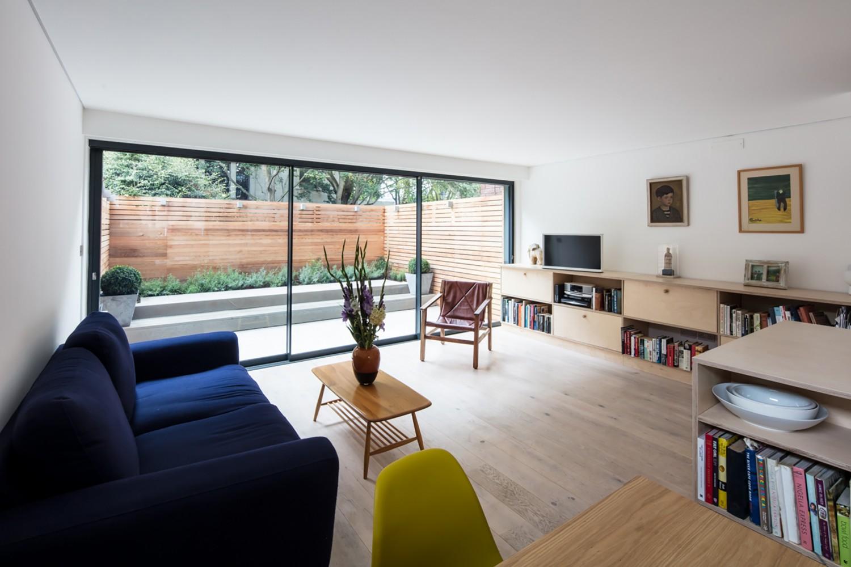 St Lukes House - Peter Morris Architects - sliding glass doors garden dog plywood